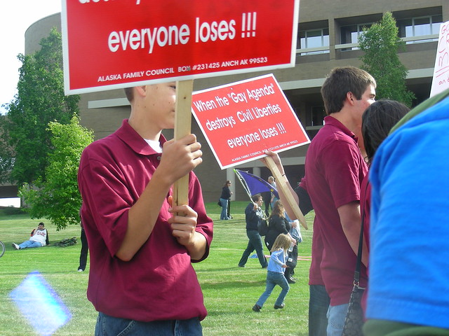 Colorado youths waving signs printed by Jim Minnery's Alaska Family Council during the summer 2009 debate on the Anchorage equal rights ordinance AO-64
