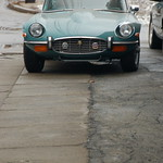 Old Jaguar E-type sports car: front view (back))