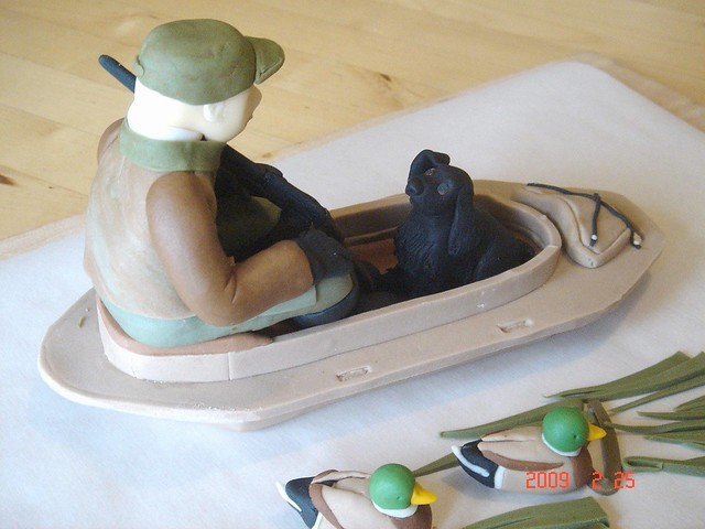 Duck hunting cake topper The dog is raising his right ear to listen to what