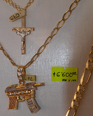 religious item(1.0), symbol(1.0), metal(1.0), chain(1.0), crucifix(1.0), cross(1.0), necklace(1.0),