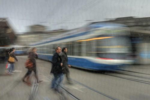 people walking near a tram