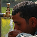 Man drinks water from tap in Kaski, Nepal