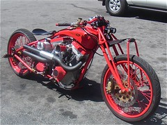 auto race(0.0), racing(0.0), motorcycling(0.0), motorcycle speedway(0.0), automobile(1.0), wheel(1.0), vehicle(1.0), motorcycle(1.0), chopper(1.0), engine(1.0), land vehicle(1.0),