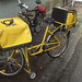 Europe 2005: Bright yellow heavy duty post office bicycle in Bamberg, Franconia, Germany