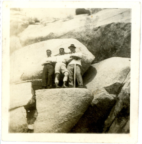three guys on a cliff