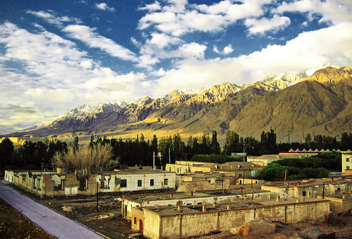 2005 china city morning travel blue light summer sky sun sunlight mountain snow color yellow clouds sunrise landscape town highway village border peak august valley xinjiang silkroad karakoram tajik himalaya centralasia canonixus400 pamir tashkurgan hindukush highplateau