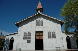 Metal church designed by Gustave Eiffel in 1884, main entrance, metal benches, and bell tower, San Rosalia, Baja California Sur, Mexico