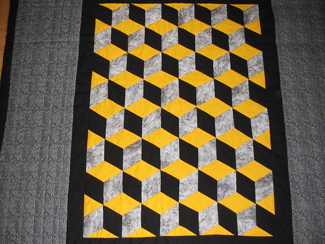 Black and yellow tumbling blocks quilt