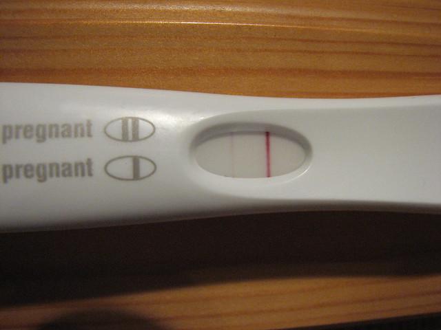 Madison : Faint positive pregnancy test but now bleeding