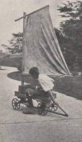 Boy Riding on Makeshift Sailboat-Wagon, 1918