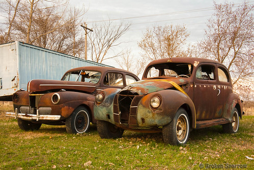 old trees sunset etched broken car metal landscape evening rust automobile dusk rusty grill weathered decrepit dilapidated corroded junker junked runningboard twodoor