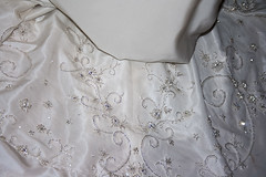 lace(0.0), collar(0.0), sleeve(0.0), blouse(0.0), shirt(0.0), art(1.0), pattern(1.0), textile(1.0), clothing(1.0), outerwear(1.0), embroidery(1.0), design(1.0),