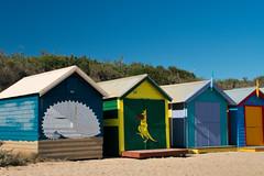 Brightly colored beach houses at Brighton Beach