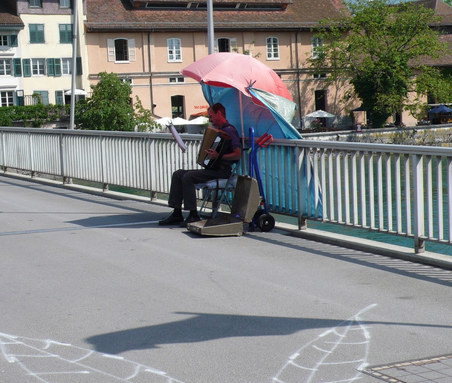Musician on the bridge over the River Aare in Solothurn