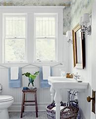 Nautical chic: Beautiful beachy blue + white bathroom + maps wallpaper