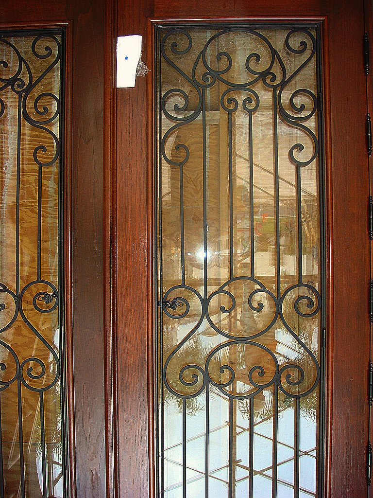 Custom Mahogany Wood Impact Doors With Wrought Iron Grills A Photo On Flickriver