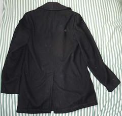 leather(0.0), overcoat(0.0), pocket(0.0), coat(0.0), pattern(1.0), textile(1.0), clothing(1.0), collar(1.0), sleeve(1.0), blazer(1.0), outerwear(1.0), jacket(1.0), black(1.0),