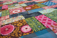 quilting(0.0), bed sheet(0.0), flooring(0.0), quilt(1.0), art(1.0), pattern(1.0), textile(1.0), patchwork(1.0), linens(1.0), craft(1.0), pink(1.0),