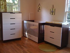 bed frame(0.0), changing table(0.0), bed(0.0), nursery(0.0), bedroom(0.0), floor(1.0), drawer(1.0), furniture(1.0), wood(1.0), room(1.0), chest of drawers(1.0), chest(1.0), wood flooring(1.0), hardwood(1.0), cabinetry(1.0),