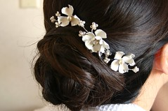 veil(0.0), bridal veil(0.0), organ(0.0), hairstyle(1.0), chignon(1.0), brown(1.0), clothing(1.0), jewellery(1.0), hair(1.0), ear(1.0), long hair(1.0), brown hair(1.0), headpiece(1.0),