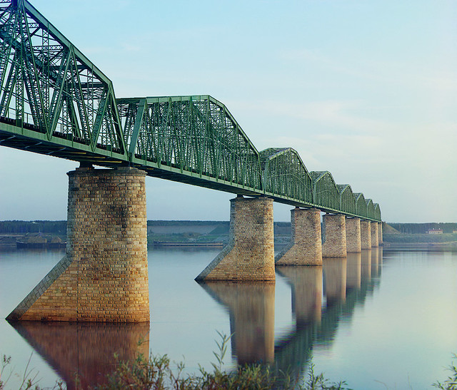 The iron bridge on stone pillars. Ural. Trans-Siberian Railroad.