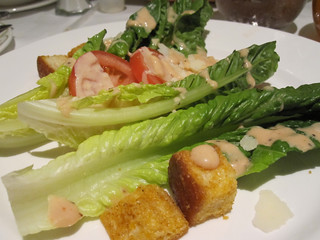 Romaine Wedge Fresh Crisp Romaine topped with a Creamy Romano Dressing and Homemade Spiced Croutons