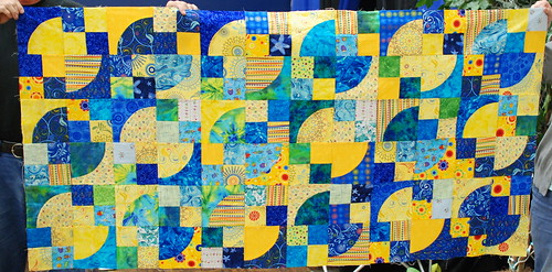 Finally, a well-lit photo of Sunfish! Soon, pinning and quilting!  Full info: domesticat.net/quilts/sunfish