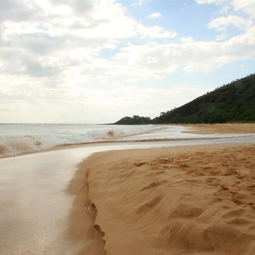 Golden sand and tall waves at Big Beach in South Maui.