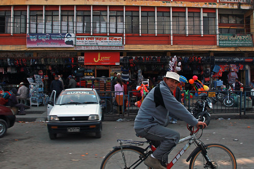 Bicyclist on city street in Nepal