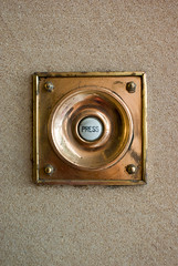 Antique Doorbell Button on a Sandstone Building