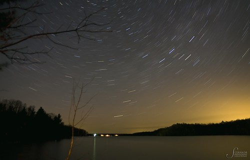 Star trails over the lake | by Scerakor