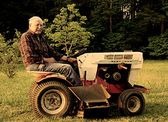 Pop on his sears mower.