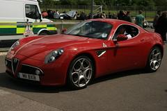 automobile(1.0), alfa romeo(1.0), vehicle(1.0), automotive design(1.0), alfa romeo 8c(1.0), alfa romeo 8c competizione(1.0), land vehicle(1.0), supercar(1.0), sports car(1.0),