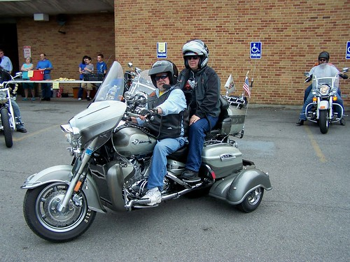 A trike with tiny rear wheels
