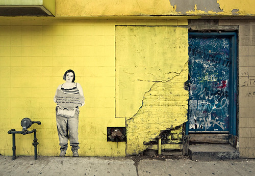 woman on yellow wall