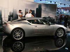 tesla roadster(0.0), automobile(1.0), lotus(1.0), vehicle(1.0), performance car(1.0), automotive design(1.0), lotus evora(1.0), auto show(1.0), land vehicle(1.0), luxury vehicle(1.0), sports car(1.0),