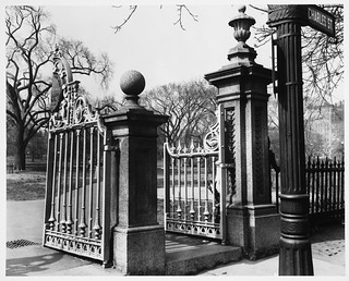 Boston Public Garden, Close Up, Cast Iron Main Gate, Carved Granite Hanging Posts at Charles Street Entrance, Intricate Design on Cast Iron Traffic Signal Post with Charles Street Sign Visible