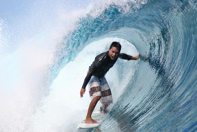Dennis Tihara is having the best time surfing at Teahupoo, Tahiti.