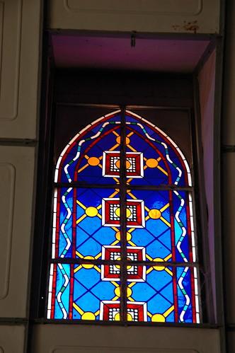 Original stained glass window, Iglesia Santa Barbara de Santa Rosalia, Designed by Gustave Eiffel, Mexican Metal Gothic Church, San Rosalia, Baja California Sur, Mexico dedicated 1887 by Wonderlane