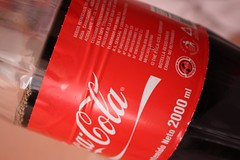 food(0.0), soft drink(1.0), red(1.0), label(1.0), carbonated soft drinks(1.0), drink(1.0), cola(1.0), coca-cola(1.0), brand(1.0),