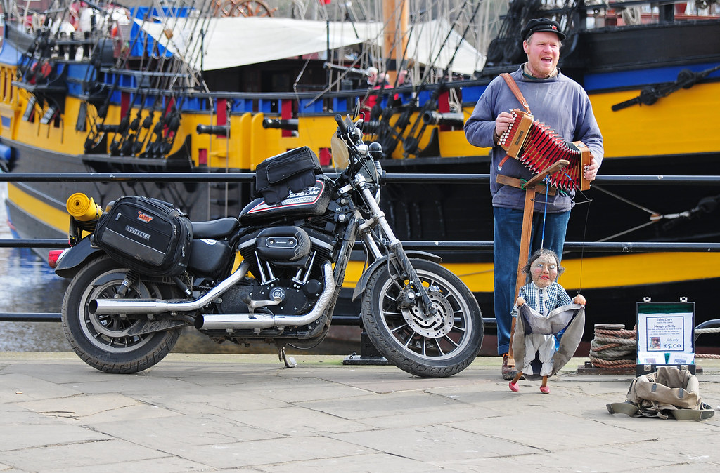 Busker, John Dory with Naughty Nelly and Harley Davidson Sportster Motorbike at Whitby Harbour, North Yorkshire