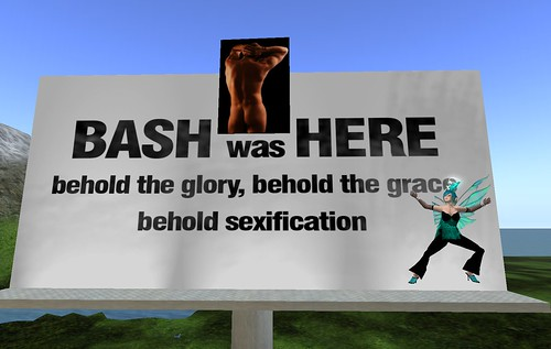 A Billboard with 'BASH was HERE. behold the glory, behold the grace, behold sexification' on it. Deoridhe Quandry, in a Teal Outfit with short teal and black hair is posed on one side gesturing upwards to the words, and a picture of Bash Quandry's offline butt is in the middle.