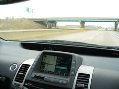 bumper(0.0), automobile(1.0), automotive exterior(1.0), vehicle(1.0), toyota prius(1.0), land vehicle(1.0),