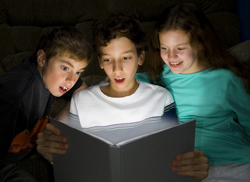 Stock Photo of Children Discovering Reading by Gragg Family