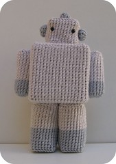 A crocheted toy robot.