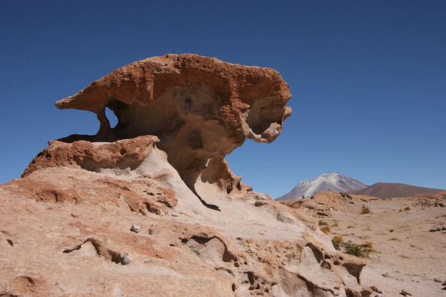 Alien head with active volcano in background