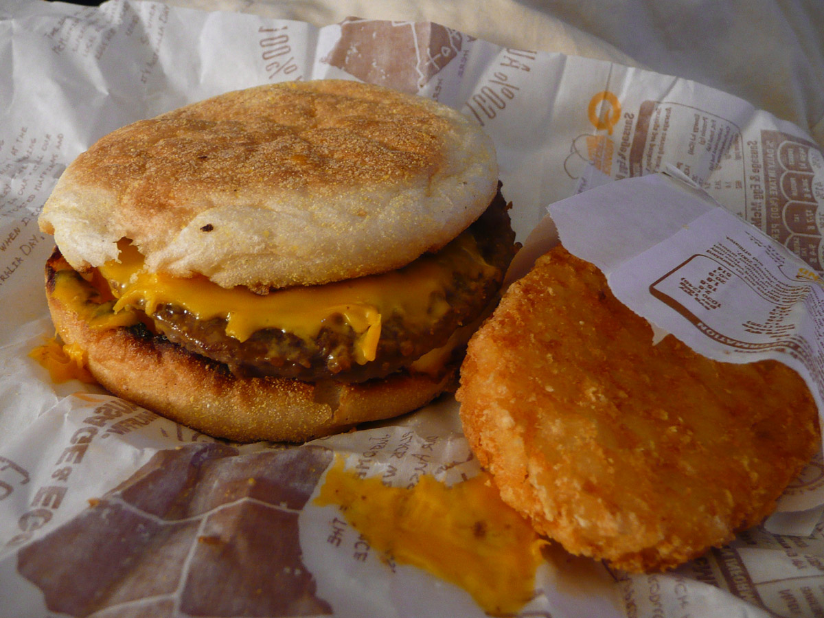 Sausage and Egg McMuffin and hash brown - a photo on ...