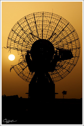 sunrise, ruins of war kuwait satellite dish