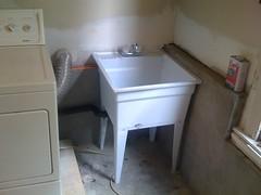 floor, furniture, room, property, plumbing fixture, sink, laundry,