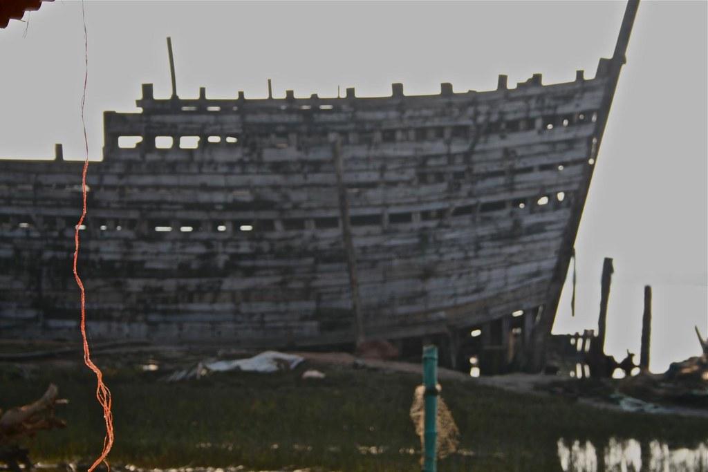 Orange Nylon against A Ship Half Built